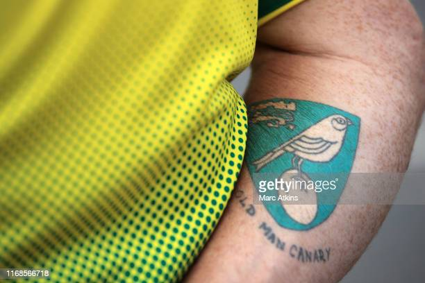 Tattoo is seen on a Norwich fan prior to the Premier League match between Norwich City and Newcastle United at Carrow Road on August 17, 2019 in...