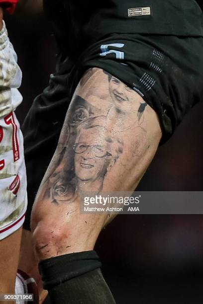 A tattoo is seen on the thigh of John Stones of Manchester City during the Carabao Cup SemiFinal Second Leg between Bristol City and Manchester City...