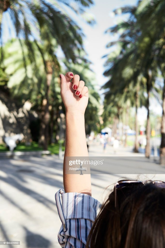 Tattoo of an airplane on forearm of young woman : Stock Photo