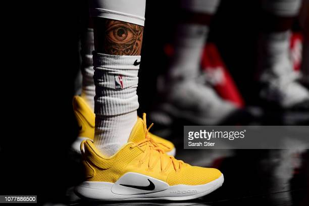 A tattoo of an eye on the leg of Shabazz Napier of the Brooklyn Nets is seen during a timeout in the fourth quarter of the game against Brooklyn Nets...