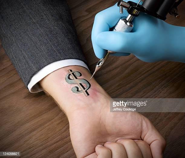 Tattoo of Dollar Sign