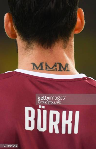 A tattoo of Dortmund's Swiss goalkeeper Roman Buerki is seen during the German First division Bundesliga football match between Borussia Dortmund and...