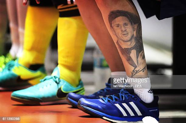 A tattoo of Lionel Messi is seen on the lower leg of one of the Argentinian back room staff during the FIFA Futsal World Cup Semi Final match between...