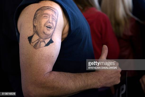 A tattoo of US Republican presidential hopeful Donald Trump is seen on the arm of Anthony Borbell during a rally March 14 2016 in Vienna Center Ohio...