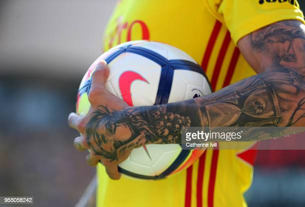 A tattoo on the arm of Jose Holebas of Watford during the Premier League match between Watford and Newcastle United at Vicarage Road on May 5 2018 in...