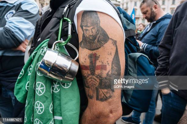 DUOMO MILANO LOMBARDIA ITALY A tattoo representing a Christian soldier during the campaign rally Matteo Salvini leader of the populist and right...