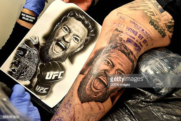 A tattoo session where a man tattoo you Conor Mcgregor fighter in the UFC's image during the 2nd tattoo artists Convention the Only Tattoo Barcelona...