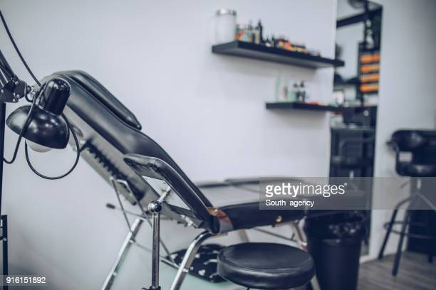 tattoo studio - tattooing stock photos and pictures