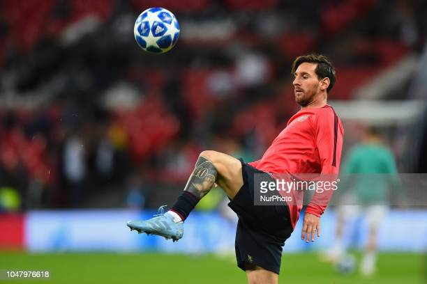 A tattooed Barcelona forward Lionel Messi warms up during the UEFA Champions League match between Tottenham Hotspur and FC Barcelona at Wembley...
