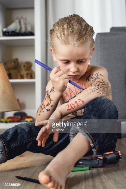 tattooed boy - fine art portrait stock photos and pictures