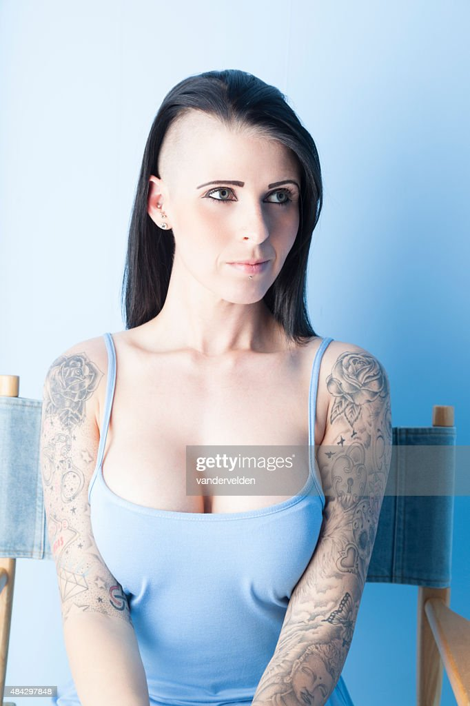 Tattooed Girl Wearing A Pastel Blue Dress : Stock Photo