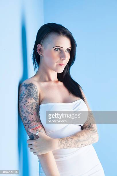 tattooed girl wearing a white dress - half shaved hairstyle stock pictures, royalty-free photos & images