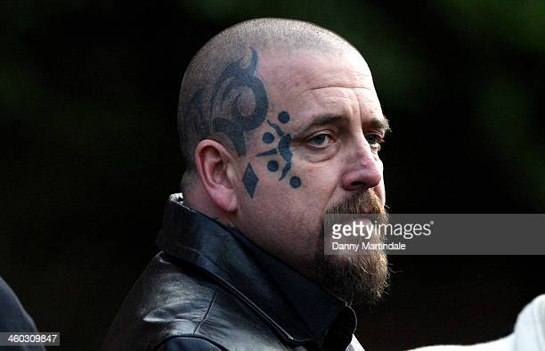 A tattooed guest attends the funeral of great train robber Ronnie Biggs at Golders Green Crematorium on January 3 2014 in London England