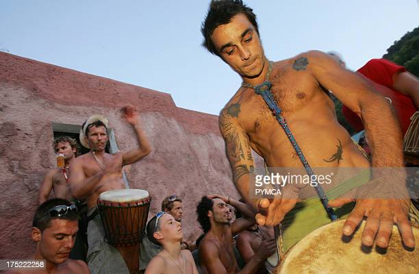 A tattooed hippy drummer Sunset beach party Benirras Beach Ibiza July 2006