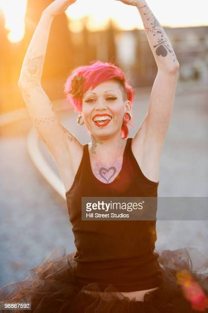 Tattooed Hispanic woman in tutu