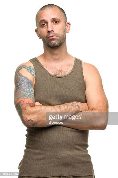Tattooed Man Crosses Arms