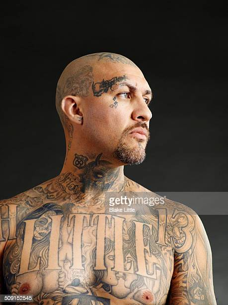Tattooed man in profile.