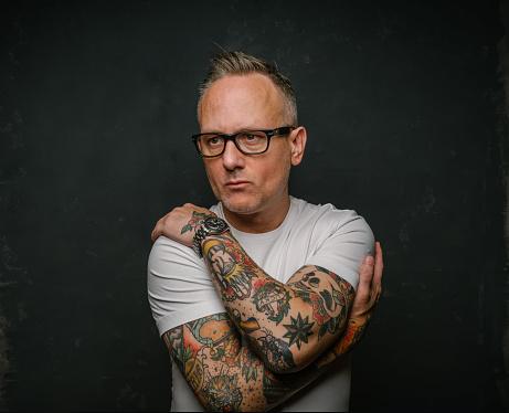 Tattooed man in white shirt - gettyimageskorea