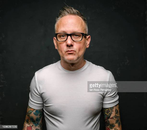 tattooed man in white shirt - white shirt stock pictures, royalty-free photos & images