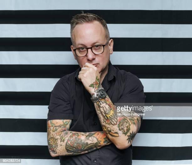 Tattooed man on striped background