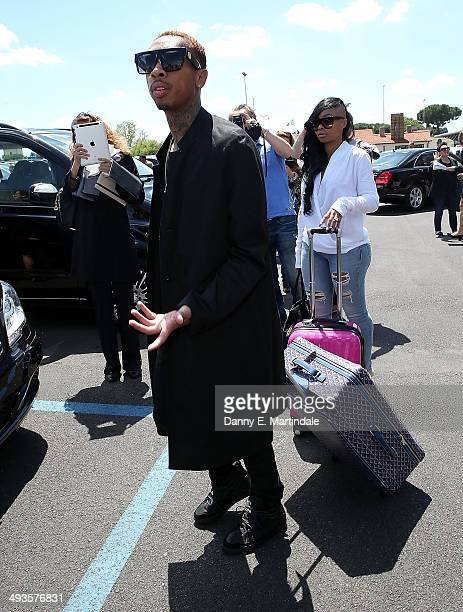 Tattooed rapper Tyga arrives at the airport ahead of Kim Kardashian And Kanye West's wedding on May 24 2014 in Florence Italy