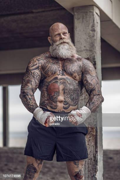 tattooed senior boxer during fighting workout - combat sport stock pictures, royalty-free photos & images