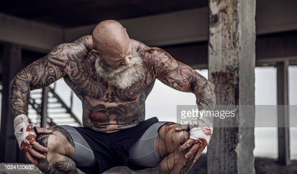 tattooed senior boxer during workout - mixed martial arts stock pictures, royalty-free photos & images