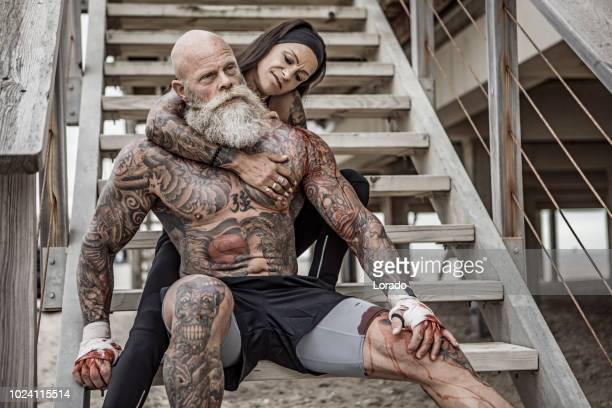tattooed senior couple posing during workout - active seniors stock pictures, royalty-free photos & images