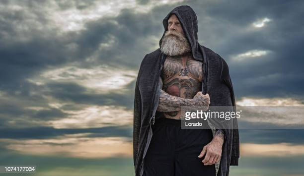 tattooed senior man during workout - combat sport stock pictures, royalty-free photos & images