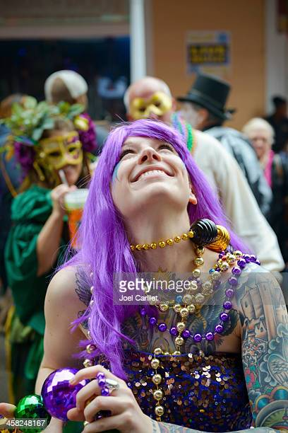 tattooed woman at mardi gras in new orleans - mardi gras fun in new orleans stock photos and pictures