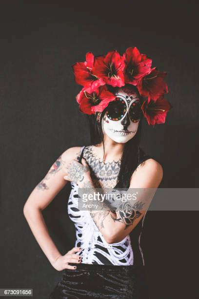 Tattooed woman celebrating Day of the dead