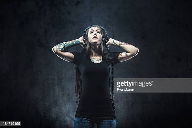 Tattooed Woman Listening to Music