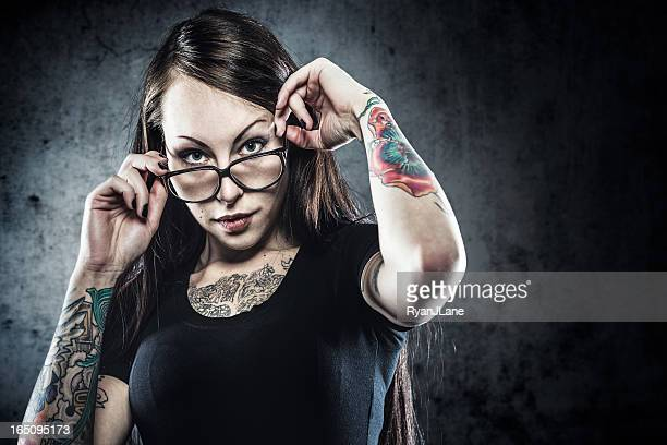 Tattooed Woman with Glasses