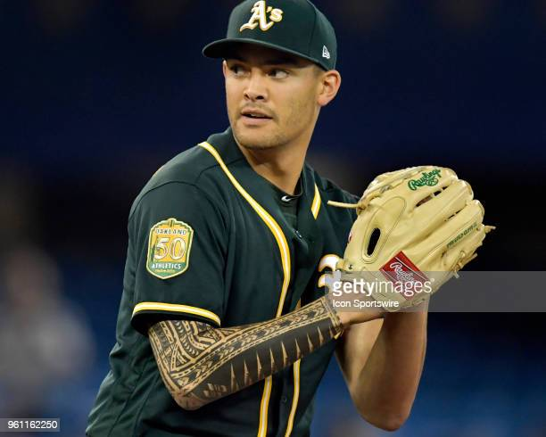 Tattoos adorn the catching arm of Oakland Athletics Starting pitcher Sean Manaea as he pitches during the MLB game between the Oakland Athletics and...