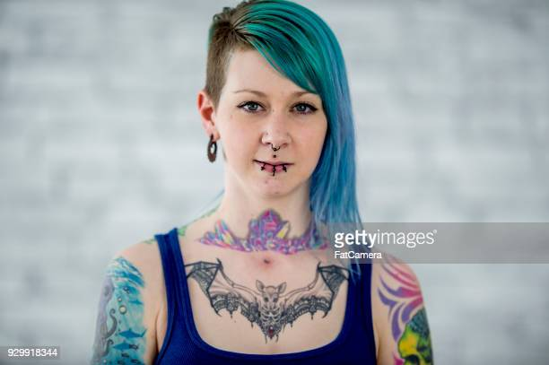 tattoos, dyed hair, and piercings - tattoo stock pictures, royalty-free photos & images