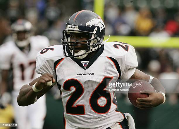 Tatum Bell of the Denver Broncos runs with the ball against the Oakland Raiders during the game at Network Associates Coliseum on October 17 2004 in...