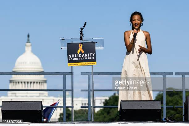"""Tatum Francois sings """"Rise Up"""" during a rally on the National Mall on May 31, 2021 in Washington, DC. Members and allies of the Asian American..."""