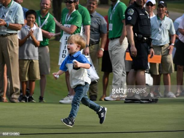 Tatum Johnson runs to his father Justin Johnson on the 18th green after the championship match at the World Golf Championships Dell Technologies...