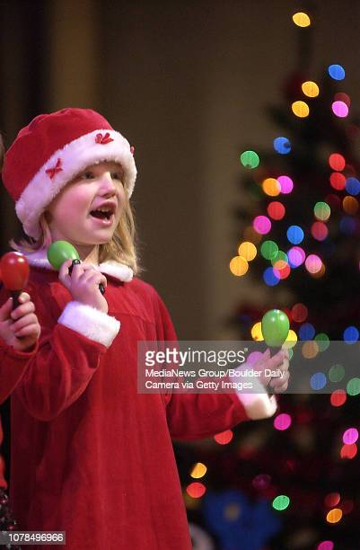 Tatum Roque sings Feliz Navidad with her class at the City of Broomfield early learning holiday show held at the Audi on Saturday