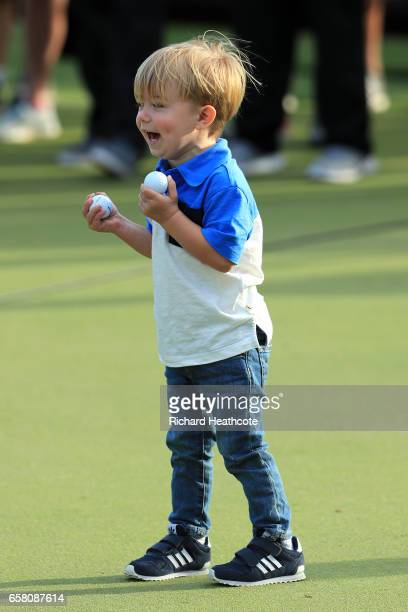 Tatum son of Dustin Johnson plays with golf balls after the World Golf ChampionshipsDell Technologies Match Play at the Austin Country Club on March...