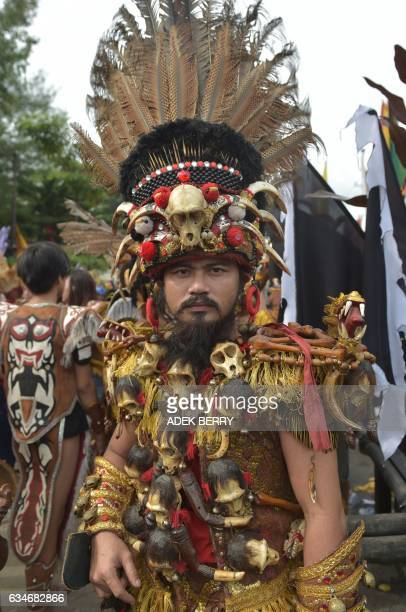 Tatung Mansyah from Dayak Iban tribe participates during the Cap Go Meh parade to mark the closing ceremony of Chinese New Year festival in...