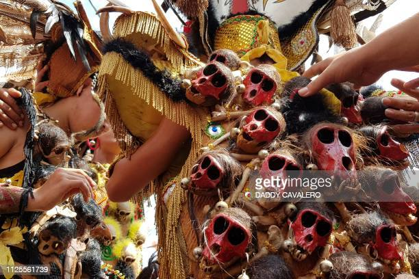 TOPSHOT Tatung men whose members include ethnic Chinese and Dayak tribespeople hold a traditional ritual one day ahead of the Cap Go Meh festival in...