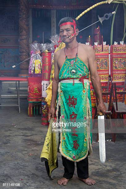 SELATPANJANG RIAU INDONESIA Tatung people possessed by the spirit of the gods or ancestors use a sharp object thought their cheeks during a piercing...