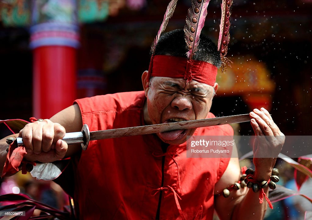 Tatung performs during Cap Go Meh celebrations on March 4, 2015 in Singkawang, Kalimantan, Indonesia. The ancient art of Tatung, performed as part of the Cap Go Meh Festival, is believed to call upon positive spirit who help to dispel the bad spirits that may affect people's lives. Cap Go Meh Festival also know as Lantern Festival is celebrated in the 15th day of Chinese Lunar Year and marks the end of the Chinese New Year celebrations.