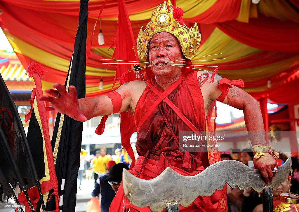 Tatung pierces metal needles trough his cheeks during Cap Go Meh celebrations on March 4, 2015 in Singkawang, Kalimantan, Indonesia. The ancient art of Tatung, performed as part of the Cap Go Meh Festival, is believed to call upon positive spirit who help to dispel the bad spirits that may affect people's lives. Cap Go Meh Festival also know as Lantern Festival is celebrated in the 15th day of Chinese Lunar Year and marks the end of the Chinese New Year celebrations.