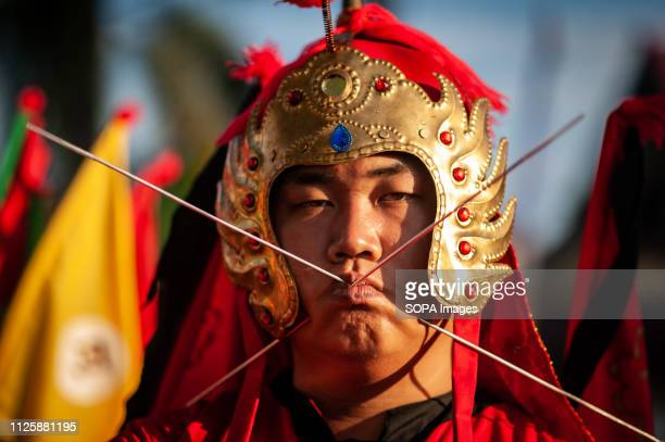 Tatung seen piercing metal needles through his cheeks during the Cap Go Meh festival celebration The ancient art of Tatung which is a part of the Cap...