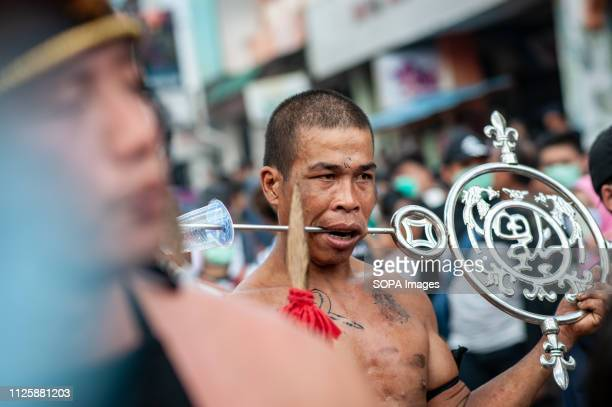 Tatung seen piercing metal through his cheeks during the Cap Go Meh festival celebration The ancient art of Tatung which is a part of the Cap Go Meh...