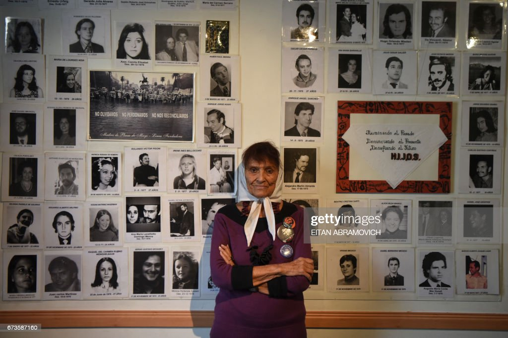 Taty Almeida, a member of the Argentine human rights group 'Madres de Plaza de Mayo', poses in front of portraits of her son Alejandro Almeida and other victims of forced disappearance, at the organization's building in Buenos Aires, Argentina, on April 20, 2017. April 30 marks the 40th anniversary of the Madres' first protest around the Plaza de Mayo square in Buenos Aires to demand the return of their children, who were forcibly disappeared during the 1976-1983 Argentine dictactorship. /