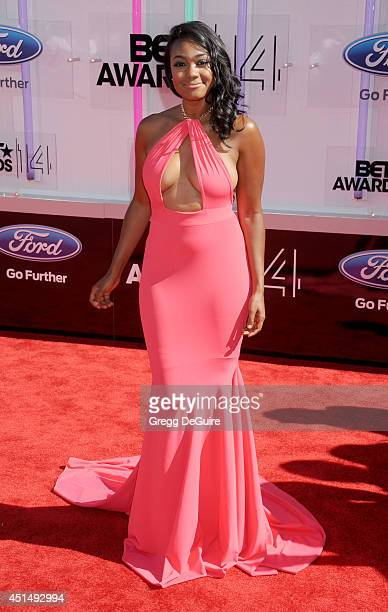 Tatyana Ali arrives at the BET AWARDS 14 at Nokia Theatre LA Live on June 29 2014 in Los Angeles California