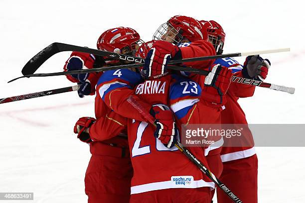 Tatyana Burina of Russia celebrates with her teammates after scoring a goal in the first period against Nana Fujimoto of Japan during the Women's Ice...